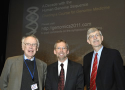 Former NHGRI   Directors, James Watson, Ph.D., co-discoverer of the structure of DNA (left),   and Francis Collins, M.D., Ph.D., NIH Director (right), pause for a photo with   Eric Green, M.D., Ph.D., current NHGRI Director before the scientific   symposium.