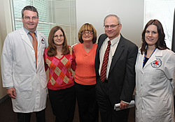 Researcher Manfred Boehm, M.D.; patients with ACDC Paula Allen and Louise Benge; UDP Director William Gahl, M.D., Ph.D.; and Researcher Cynthia St. Hilaire, Ph.D.
