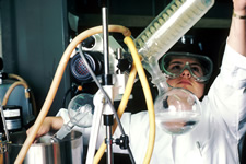 A scientist performing drug synthesis in a laboratory setting. Photo courtesy of National Cancer Institute