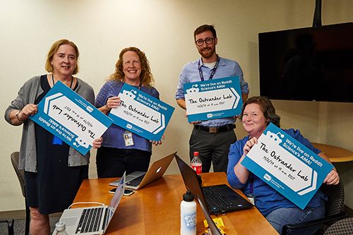 Researchers hold reddit signs