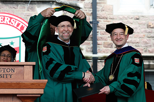NHGRI director, Eric D. Green, M.D., Ph.D., receives an honorary degree from Washington University in St. Louis chancellor Mark S. Wrighton, Ph.D. Image credit: Joe Angeles, Washington University.