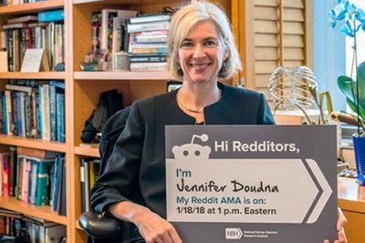 Jennifer Doudna holding a sign
