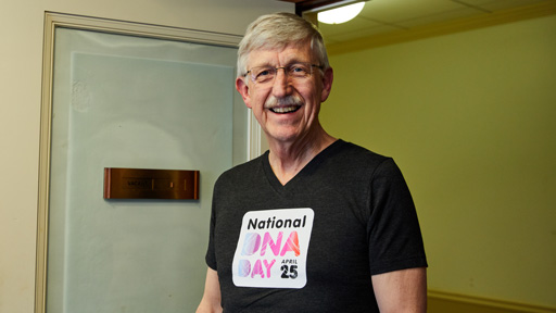 Dr. Collins wearing a fitted DNA Day shirt