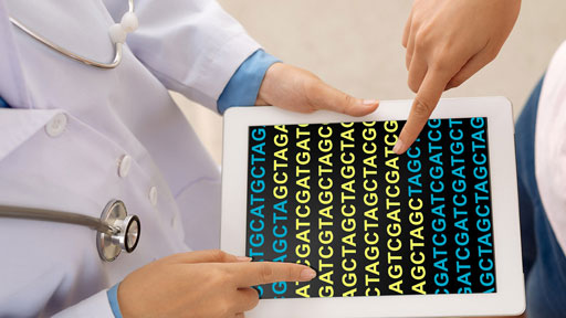 Doctor and patient looking at patient's genomic data